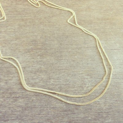 Gold necklace by Tanja Ting